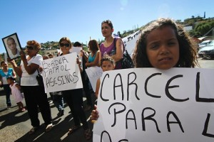From left to right: Taide Elena, Araceli Rodriguez, Selma Barrón and Andrea Paula Elena Rodriguez, Jose Antonio's younger sister, protest in front of the U.S./Mexico port of entry Saturday morning. About 30 family members, friends and supporters of Jose Antonio attended the protest, which started at Plaza de Hildalgo and continued to the port of entry and then to the site where Elena Rordriguez was shot. Credit: Josh Morgan