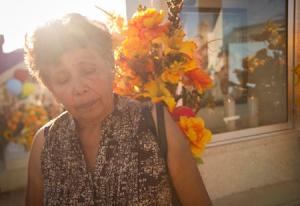 Taide Elena, Jose Antonio's grandmother, paying her respects at her grandson's grave. Credit: Josh Morgan