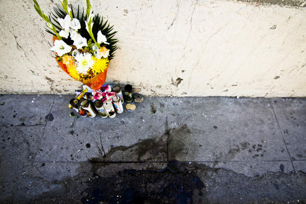 A small altar marks the spot where José Antonio died. Blood stains were visible for several days after he was killed October 10, 2012.